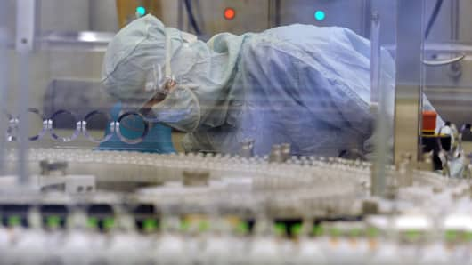 An employee works on a high speed production line of insulin at a factory of Novo Nordisk.