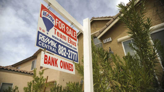 A 'bank-owned' sign sits outside a foreclosed home in the Mountain's Edge neighborhood of Las Vegas, Nevada, in 2010.