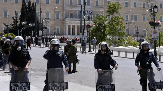 Greek riot policemen during a rally marking International Labor Day in Athens on May 1, 2014