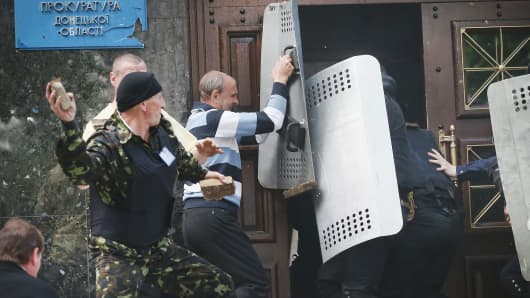 Pro-Russian activists storm the prosecutors office on May 1, 2014 in Donetsk, Ukraine.