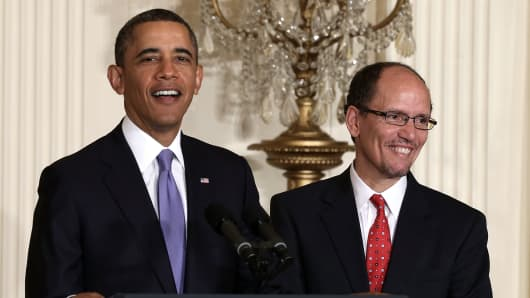 President Barack Obama stands with Labor Secretary Thomas Perez.