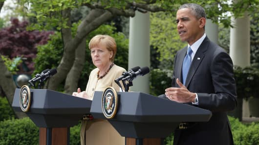German President Angela Merkel and U.S President Barack Obama address the media in the Rose Garden at the White House on May 2, 2014 in Washington.