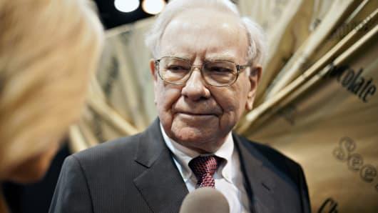 Warren Buffett, chairman of Berkshire Hathaway Inc., tours the exhibition floor prior to the Berkshire Hathaway shareholders meeting.