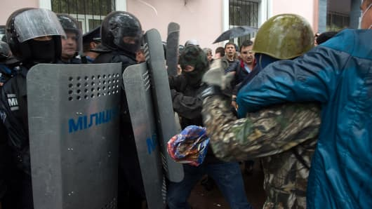Pro-Russian militants clash with police as they storm the police station in the southern Ukrainian city of Odessa
