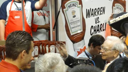 Warren Buffett visit's the Heinz ketchup truck at the 2014 Berkshire Hathaway Annual Shareholder's Meeting in Omaha, Nebraska.