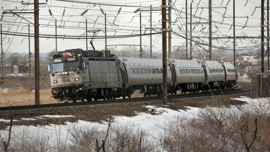 A New Jersey Transit train travels east-bound in North Bergen, New Jersey, near one of the two commuter rail tunnels connecting New Jersey to New York.