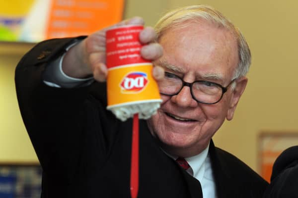 Billionaire investor Warren Buffett flips over a Dairy Queen Blizzard treat, the most successful product ever released in the history of Dairy Queen.