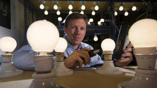 John Goscha, Founder and CEO  of the Finally Light Bulb Company, inspecting new light bulbs that feature  Acandescent technology in Woburn, MA  on  March 10 , 2014.