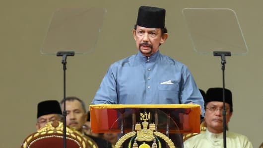 Brunei's Sultan Hassanal Bolkiah delivers a speech during the official ceremony of the implementation of Sharia Law in Bandar Seri Begawan on April 30, 2014.