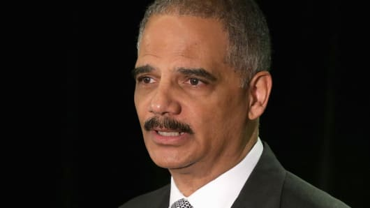 U.S. Attorney General Eric Holder delivers the keynote address to the National Association of Attorneys General Traning and Research Arm's symposium on the reduction of crime at the The Westin Georgetown hotel May 5, 2014 in Washington.