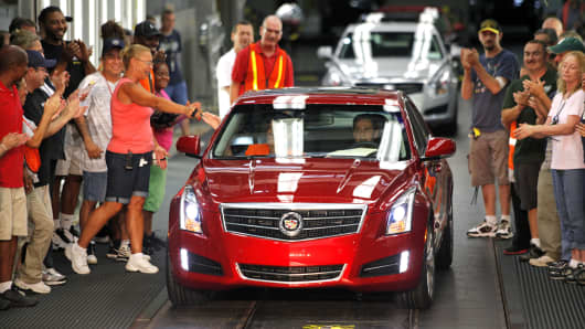 The first 2013 Cadillac ATS rolls off the assembly line at the General Motors Lansing Grand River Assembly Plant July 26, 2012 in Lansing, Michigan.