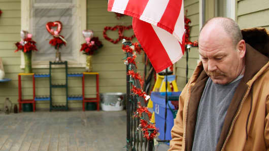 In this photo made on Saturday, March 1, 2014, William Saum stands near his front porch in Clarksburg, W. Va. In March of 2013, a truck carrying drilling water overturned onto a car carrying his wife and two young sons. Both children, 7-year-old Nicholas Mazzei-Saum and 8-year-old Alexander, were killed.
