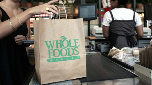 A customer checks out of a Whole Foods Market in Washington, D.C.