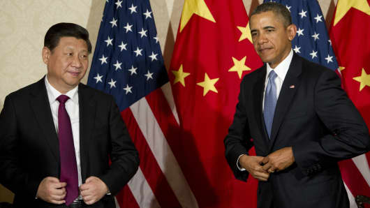 President Barack Obama and Chinese President Xi Jinping (L) meet at the US ambassador's residence in The Hague on March 24, 2014 ahead of the Nuclear Security Summit (NSS).