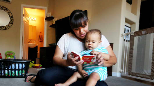 Marisa Mauer, 34, shares a precious moment with son Nathaniel, 13 months, at their home in San Diego on May 3, 2014.