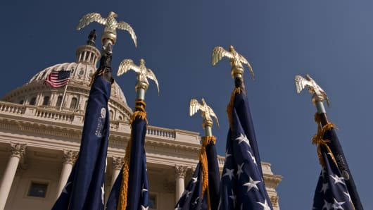 U.S. flags stand ready below the dome of the U.S. Capitol on the West Front. They were set up for the signing ceremony for HR 5297--a $30 billion lending fund that will provide for a variety of small-business tax provisions.