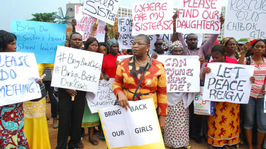 Former education minister Obiageli Ezekwesilieze, center, marches with concerned residents and parents of the kidnapped girls in Abuja, Nigeria.