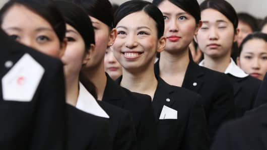 New employees of Japan Airlines line up at a welcoming ceremony in Tokyo on April 1, 2014