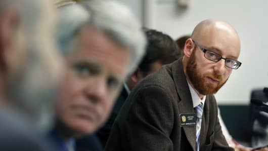 Rep. Jonathan Singer, D-Longmont, listens to discussion on a bill he sponsored which would allow marijuana dispensaries to form financial co-operatives, at the Colorado Legislature, in Denver, Wednesday May 7, 2014.