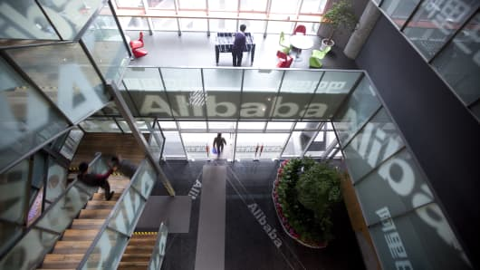 People walk through Alibaba.com Ltd.'s headquarters in Hangzhou, Zhejiang Province, China.
