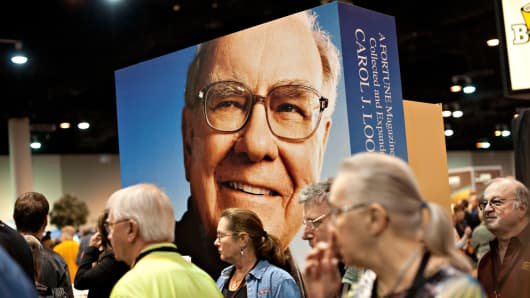 Shareholders surround a large scale portrait of Warren Buffett, chairman of Berkshire Hathaway, during the company's shareholders meeting in Omaha, Nebraska, May 3, 2014.