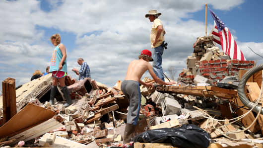 Relatives of Bob Butts help look for items to salvage from his home after it was destroyed on Monday by a tornado on April 30, 2014 in Louisville, Mississippi.