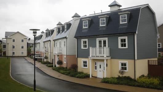 Properties stand on a cul-de-sac in a development of New England-style residential homes known as The Hamptons in the Worcester Park district of London, U.K.