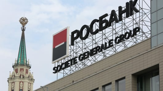 A logo stands above the headquarters of OAO Rosbank in Moscow, Russia