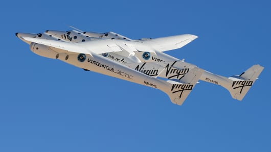 Virgin Galactic WhiteKnightTwo, carrying SpaceShipTwo, takes flight over Spaceport America, northeast of Truth Or Consequences in New Mexico.
