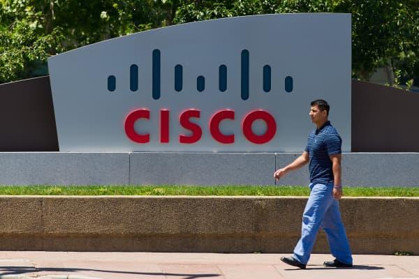 A pedestrian walks past Cisco Systems Inc. signage