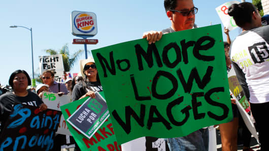 Fast-food workers and supporters organized by the Service Employees International Union protest outside of a Burger King Worldwide Inc. restaurant in Los Angeles,  Aug. 29, 2013.