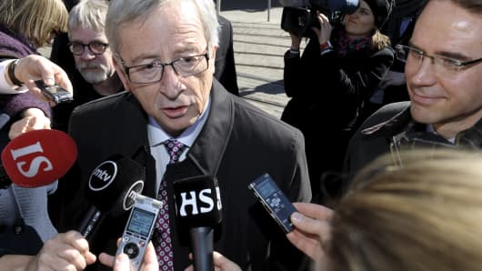 Jean-Claude Juncker (L), Luxembourg's former prime minister and European People's Party EPP candidate for the presidency of the European Commission speaks to journalists after attending the Finnish National Coalition Party's European elections campaign in Helsinki, Finland on April 16, 2014.