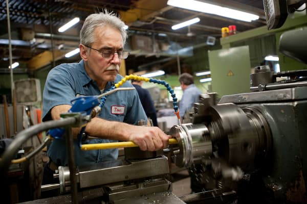A machinist operates a lathe at the Windle Mechanical Solutions manufacturing facility in Philadelphia.