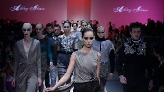 Models showcase design by Ashley Isham during the Audi Fashion Festival on day two at Tent at Orchard on May 15, 2014 in Singapore.