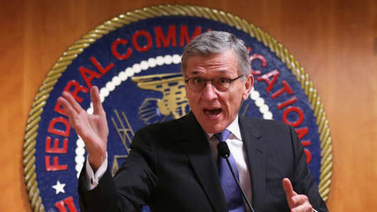 Federal Communications Commission (FCC) Chairman Tom Wheeler speaks during a news conference after an open meeting to receive public comment on proposed open Internet notice of proposed rulemaking and spectrum auctions May 15, 2014 at the FCC headquarters in Washington, DC.