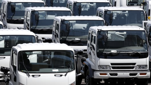 Trucks bound for bound for shipment sit parked at a port in Yokohama, Kanagawa Prefecture, Japan.