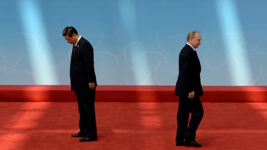 Russian President Vladimir Putin leaves after being greeted by Chinese President Xi Jinping at the fourth Conference on Interaction and Confidence Building Measures in Asia (CICA) summit in Shanghai on May 21, 2014.