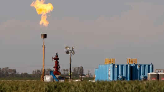 Gas is flared as waste from the Monterey Shale formation where gas and oil extraction using hydraulic fracturing, or fracking, is on the verge of a boom on March 22, 2014 near Buttonwillow, Calif.