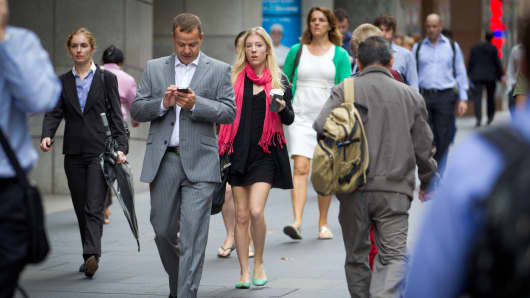 Pedestrians walk in the central business district of Sydney, Australia.