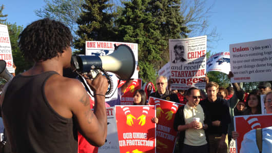 McDonald's employees protesting for a higher minimum wage outside the McDonald's annual shareholder's meeting in Oak Brook, IL.
