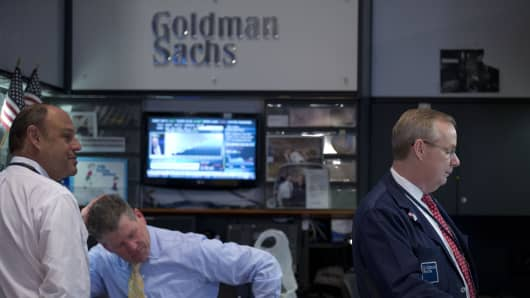Traders work at the Goldman Sachs Group Inc. booth on the floor of the New York Stock Exchange (NYSE).