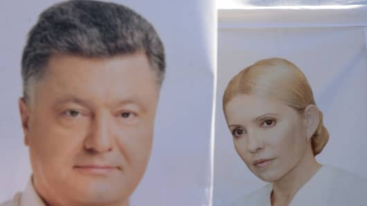 Placards depecting presidential candidates Yulia Tymoshenko (R) and Petro Poroshenko (L) are pictured in the western Ukrainian city of Lviv in thee last election on May 21, 2014.