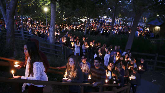 People gather at a park for a candlelight vigil to honor the victims of Friday night's mass shooting on Saturday, May 24, 2014, in Isla Vista, Calif. Sheriff's officials say Elliot Rodger, 22, went on a rampage near the University of California, Santa Barbara, stabbing three people to death at his apartment before shooting and killing three more in a crime spree through a nearby neighborhood.