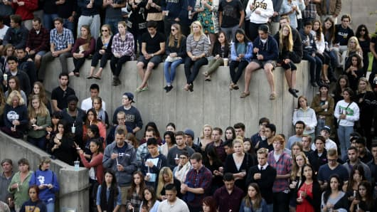 Students gather for a candlelight vigil to honor the victims of Friday night's mass shooting on Saturday, May 24, 2014, on the campus of the University of California, Santa Barbara.