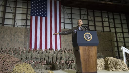 US President Barack Obama speaks during a surprise visit with US troops at Bagram Air Field, north of Kabul, in Afghanistan, May 25, 2014, prior to the Memorial Day holiday.