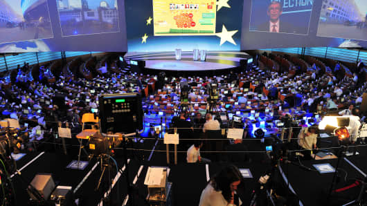 A general view shows press crews working in the hemicycle of the European Parliament during the announcement of the European Parliament elections results in Brussels.