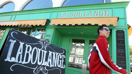 A pedestrian passes by a La Boulange Bakery on June 5, 2012 in San Francisco, Calif.