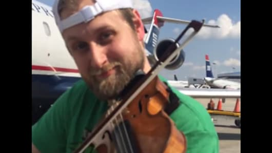 U.S. Airways restricts two musicians from carrying on their instruments onboard their flight.