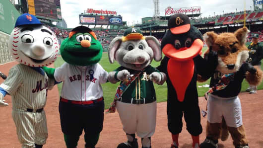Major League Baseball mascots get together for a photo at Fenway Park in Boston.
