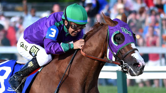 California Chrome with jockey Victor Espinoza wins the 139th running of the Preakness Stakes at Pimlico Race Course on May 17, 2014 in Baltimore, MD.